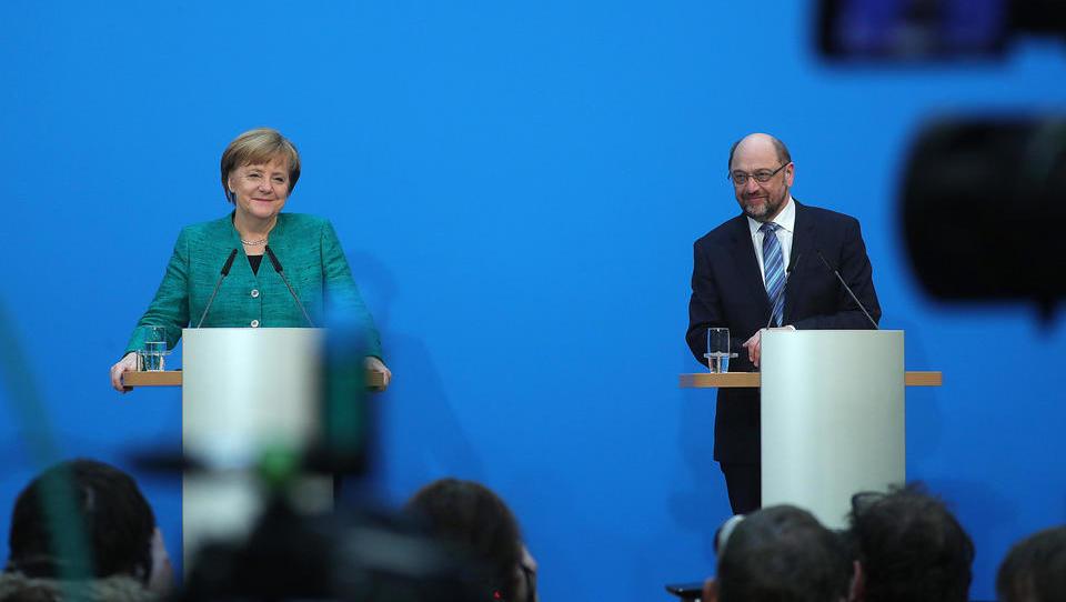 Člani nemške SPD podprli vstop v veliko koalicijo pod vodstvom Angele Merkel