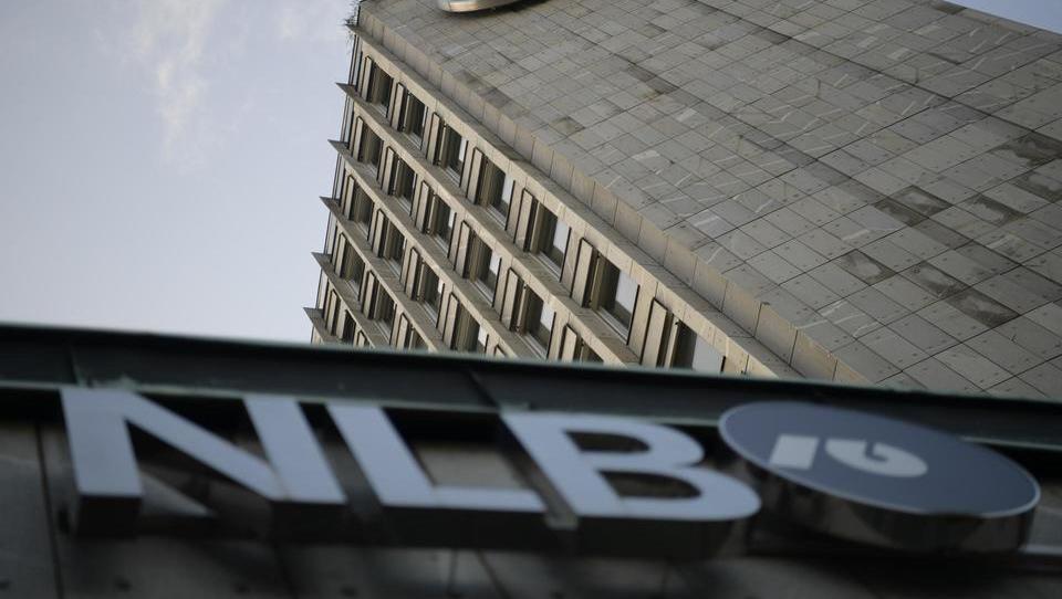 Iz Bruslja hladen tuš zaradi nespoštovanja zavez o prodaji NLB